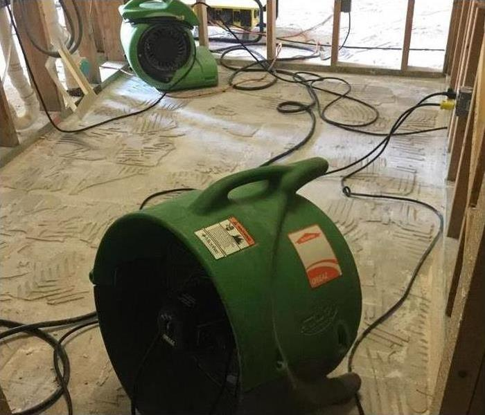 Our drying equipment inside a property drying the floor