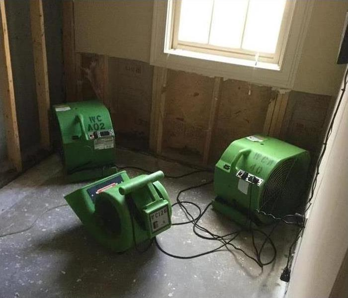 Air movers (drying equipment) in a room