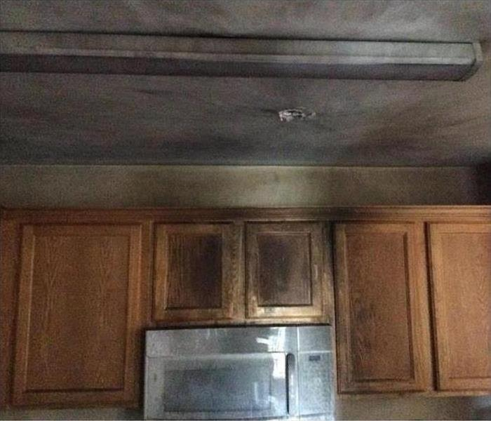 Cabinets of a home covered with smoke