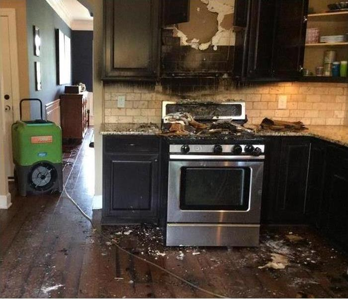 burned stove and kitchen cabinets